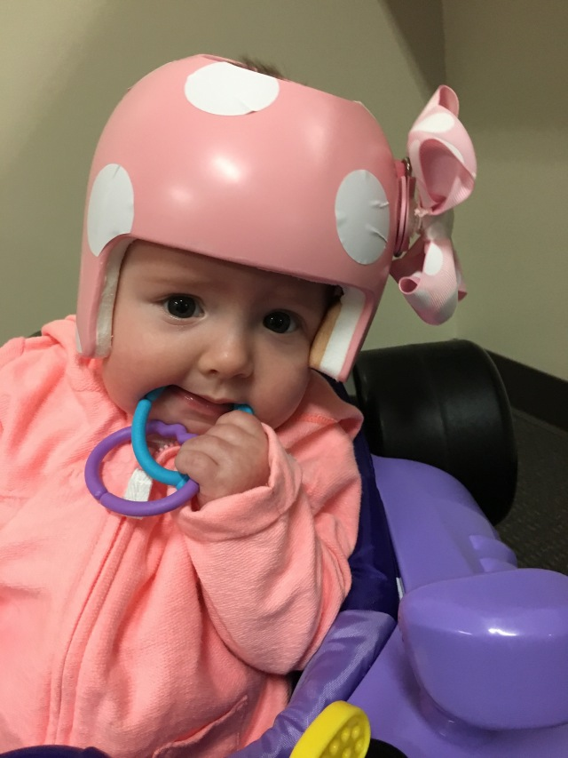 Plagiocephaly helmet with polka dots and a bow